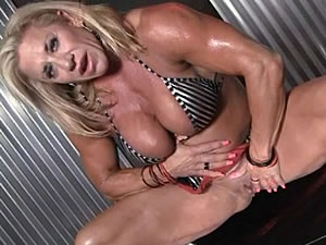 Muscled blonde mature masturbates on camera