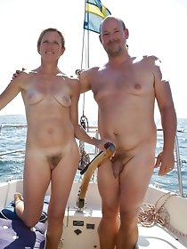 Happy nudist couples love sea adventures
