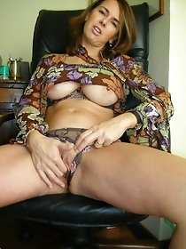 Amazing redhead MILF masturbates and gets an orgasm