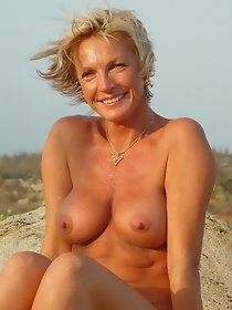 Charming blonde mom posing naked outdoor