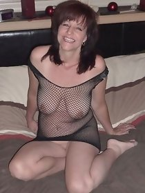Charming mature lady in dark fishnet