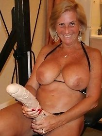 Busty tanned mature likes big strapons