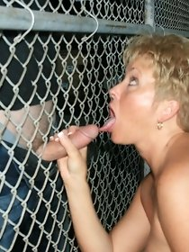 Obedient blonde wife sucks dick in an iron cage